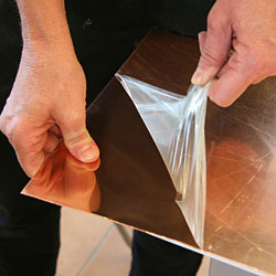 Peeling of contact paper for deep etching. The copper plate is 1 mm thick.