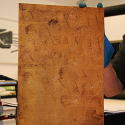 The copper plate is prepared for the first etching bath.
