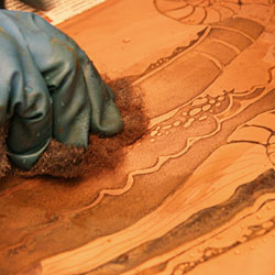 Cleaning of the etched parties with steel wool.