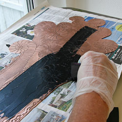 The ink is applied with a rubber filler.