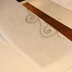 The thin paper is turned upside down in order to flip the pattern horizontally.