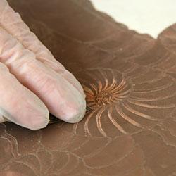 Sanding with wet sandpaper for metal.