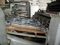 The prints are fed into the the printing-press.