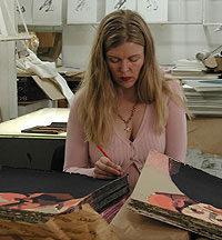 Cecilia Sikström signing one of her prints.